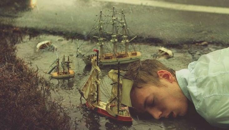 hombre conectado a los sueños mientras duerme sobre un charco