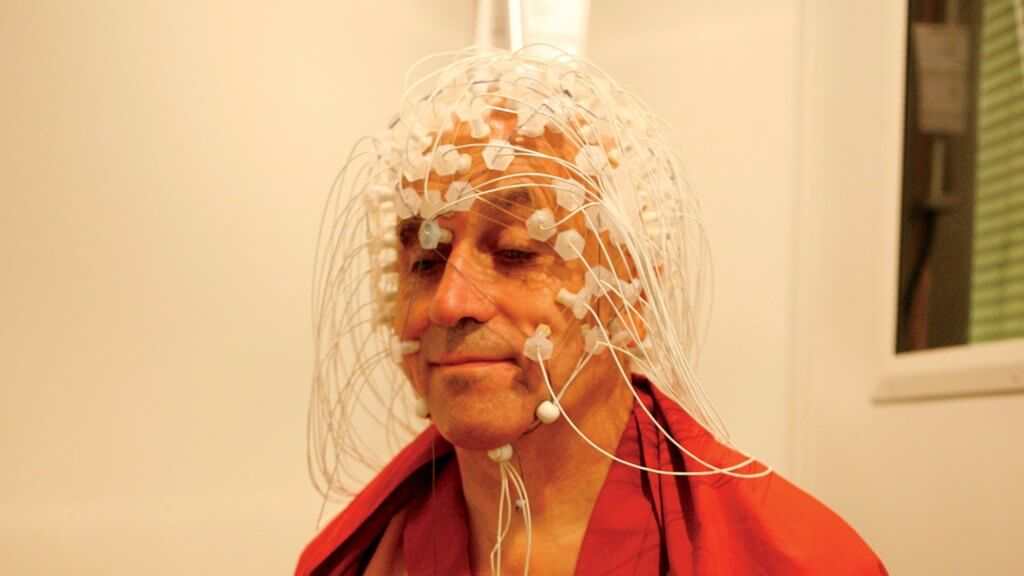 Matthieu Ricard, the happiest man in the world, with electrodes on his head