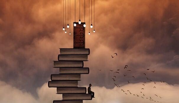torre de libros con hombre sentado que busca desarrollar el poder la lectura y empatía