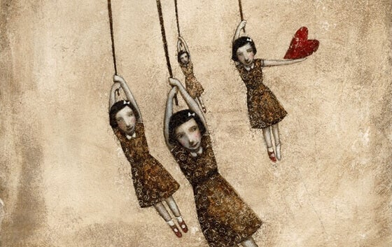 dolls hanging from strings