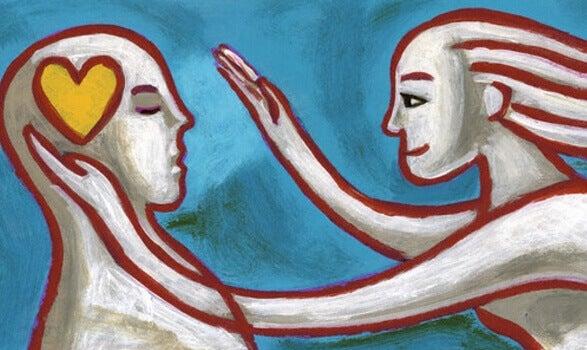 Mujer acercándose a un hombre con corazón en la cabeza representando la terapia centrada en la compasión