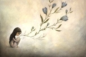 Niña sentada y prendida por ramo de flores