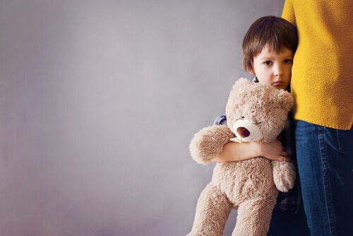boy holding teddy bear