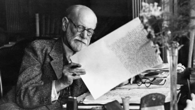 Sigmund Freud working at his desk