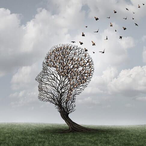 Árbol con forma de cabeza representando la depresión