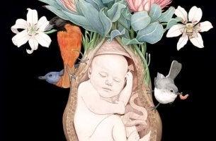 Bebé en el útero rodeado de pájaros y flores
