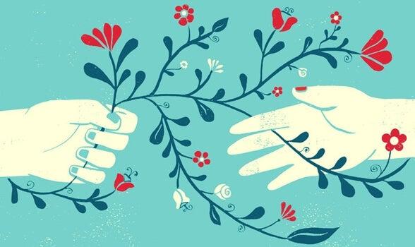 manos con flores representando la terapia centrada en la compasión