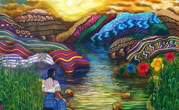 mujer ante montañas de colores representando la sabiduría Tolteca