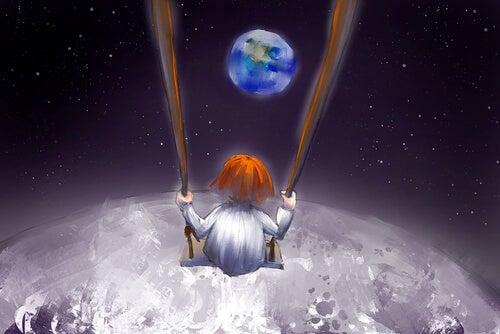 Niña en un columpio sobre la luna