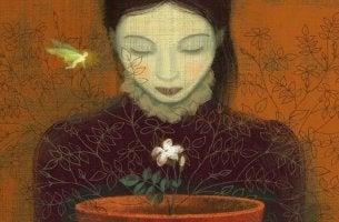 mujer mirando flor intentando hacer predicciones