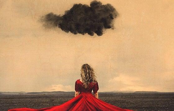 nube sobre chica con vestido rojo simbolizando el arte de tómate tu tiempo