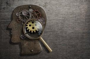 Cabeza de una persona con un mecanismo en su mente simbolizando la antipsiquiatría de David G. Cooper
