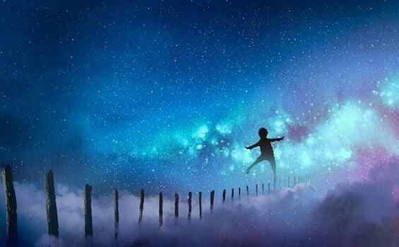 niño cruzando barreras en el cielo representando el deseo de haz algo que te dé miedo