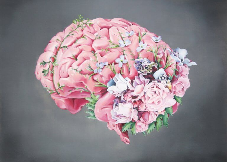 Cerebro rosa con flores representando las frases de Antonio Damasio