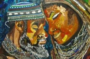pareja de zulúes dedicándose el saludo de sawubona