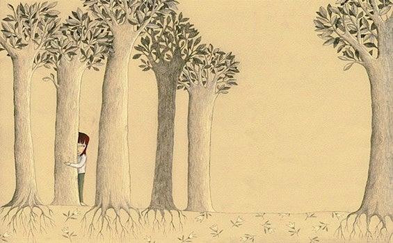 niña escondida tras árbol simbolizando la edad emocional del desamor