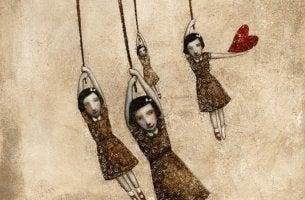 niñas pendidas simbolizando la edad emocional del desamor