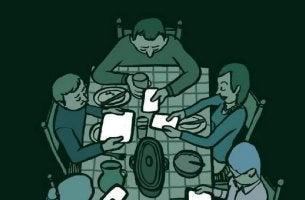 Personas sentadas a la mesa con los telefonos