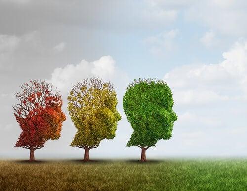 Árboles con hojas en forma de cabezas representando el enfoque de Karl Jaspers