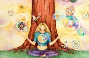 Chica ante un árbol fortaleciendo su sistema inmune emocional