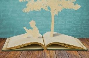 Libro abierto con la figura de un libro y un árbol