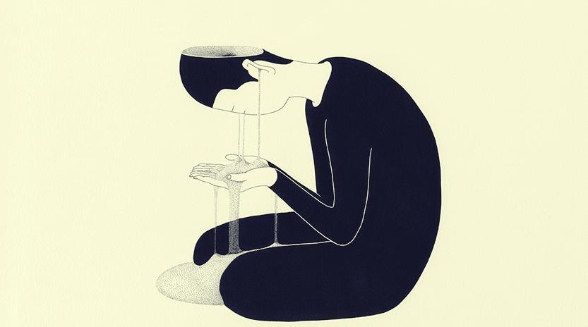 Hombre que se mira las manos y que que experimenta la pérdida de memoria por depresión