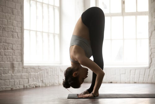 Woman performing yoga asanas for better sleep