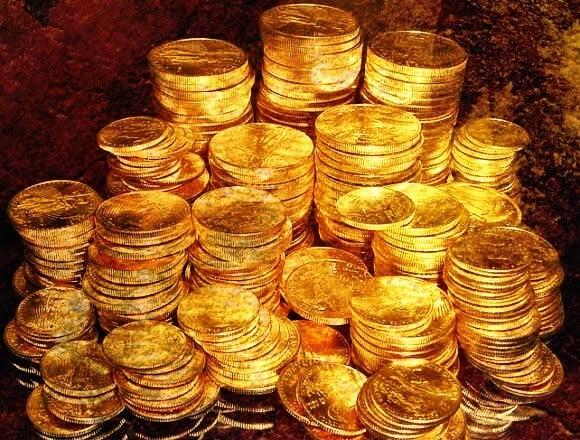 monedas de oro simbolizando el el círculo del 99