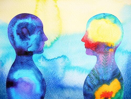 Perfiles de dos personas mirándose de frente simbolizando la neurociencia social