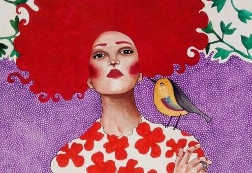 mujer con pájaro simbolizando los rasgos de las personas emocionalmente fuertes
