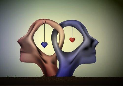 Dos cabezas de una pareja con corazones unidas para representar los juegos psicológicos