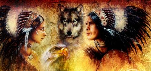 Mujer india con un lobo y un hombre indio simbolizando la medicina del lobo