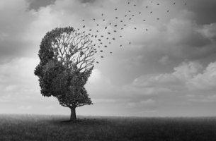 Árbol con forma de cabeza con hojas volando para representar la demencia con cuerpos de Lewy