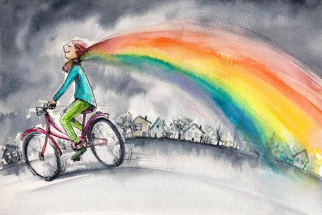 chica en bici con arcoiris simbolizando el espacio psicológico