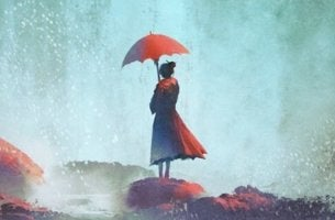 mujer con paraguas rojo pensando en el miedo al abandono