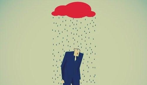 hombre con nube simbolizando los síntomas de depresión