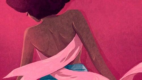 mujer con lazo rosa simbolizando el cáncer de mama