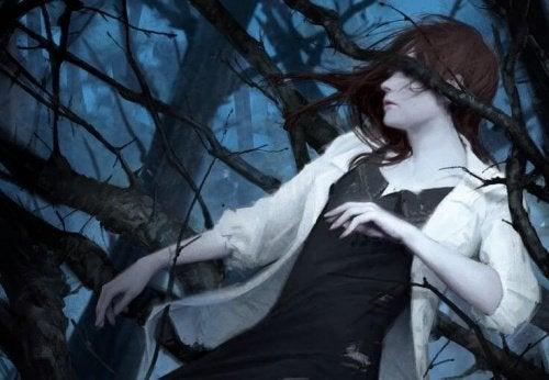 chica entre ramas simbolizando los síntomas de depresión