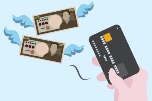 dinero y tarjeta de crédito simbolizando el síndrome del saldo en rojo