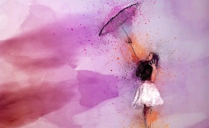 chica con paraguas que invierte en su sistema inmunitario psicológico