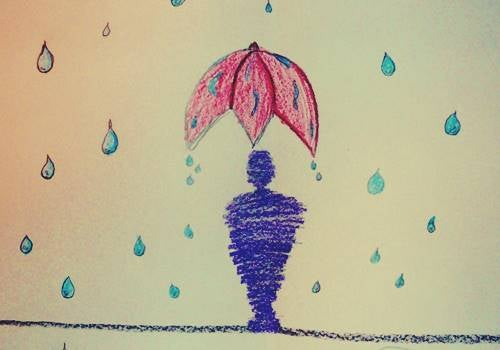 Hombre bajo lluvia