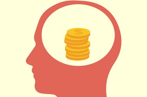 cabeza con dólares simbolizando la psicología del ahorro