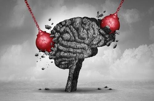 Bolas golpeando un cerebro para representar el daño cerebral