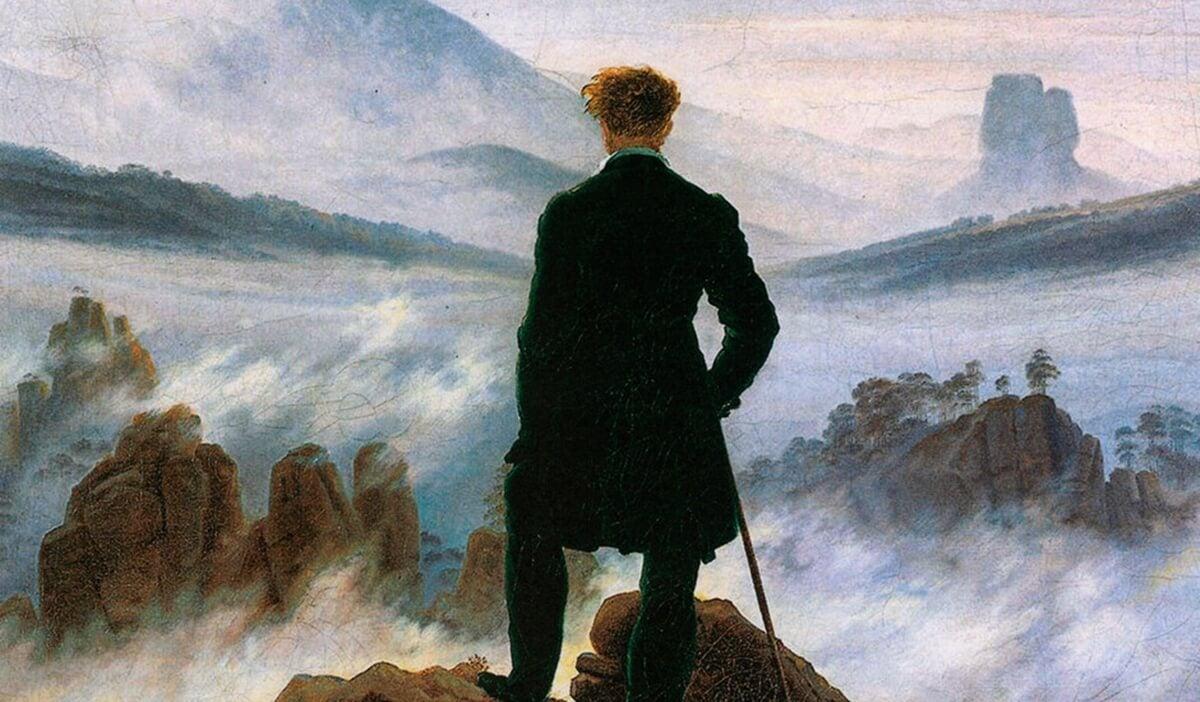 hombre ante mar de nubes representando el efecto Weltschmerz