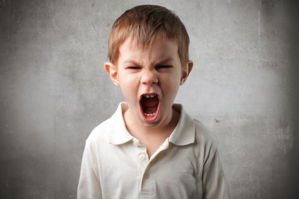 Angry child representing why laughter spreads only to some people