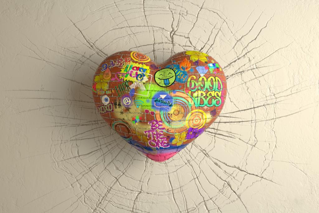 Stone heart with graffiti on a wall representing the mudita