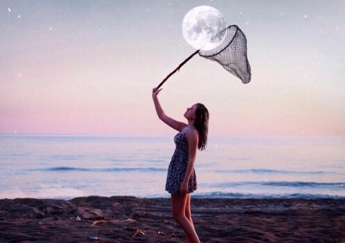 woman catching moon in net